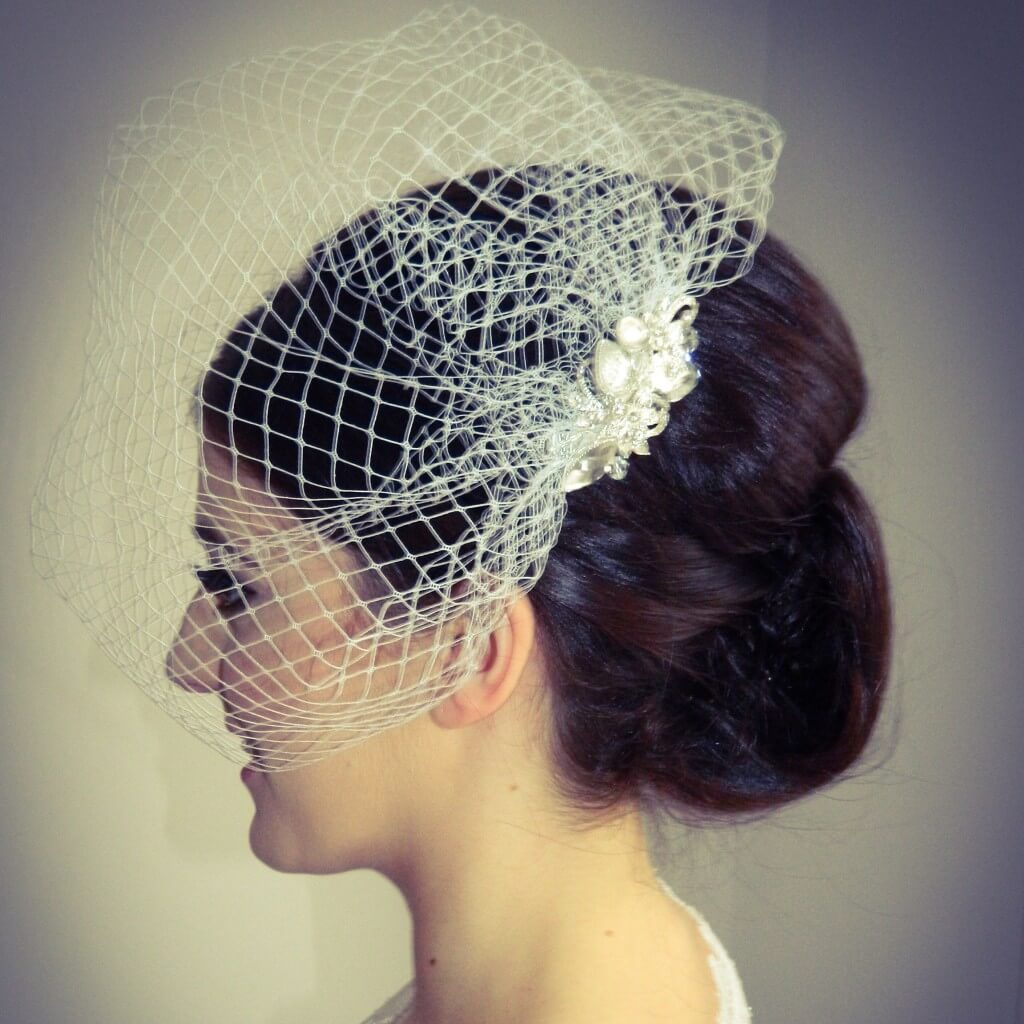 Emma wearing a beautiful bird cage veil available @ macbrides-weddings.co.uk